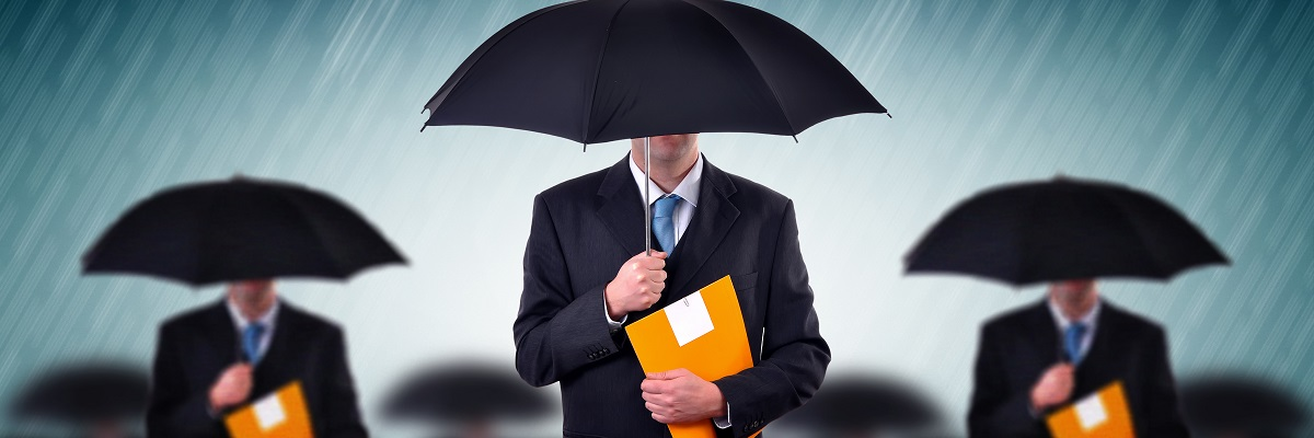 Businessman with umbrellas in heavy rain.