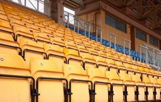 Plenty of yellow plastic seats at stadium