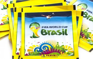 SWINDON, UK - APRIL 5, 2014: Panini FIFA World Cup 2014 Stickers on a white background