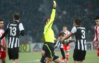 THESSALONIKI, GREECE - FEBRUARY 5: Kostas Stafilidis received a yellow card by the referee Thanasis Giahos in football match between Paok and Olympiakos